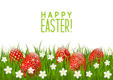 Red Easter eggs on green grass Stock Image