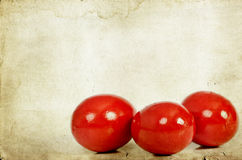 Red Easter eggs on grunge paper Royalty Free Stock Images