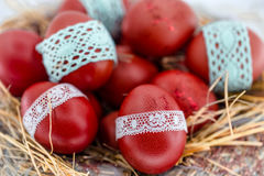 Red Easter eggs in a nest of hay Royalty Free Stock Photography