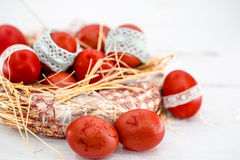 Red Easter eggs in a nest of hay Stock Photography