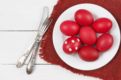 Red Easter eggs in plate Stock Photo