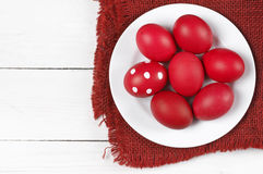 Red Easter eggs in plate Royalty Free Stock Photo