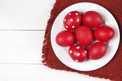 Red Easter eggs in plate Stock Photography