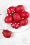 Red Easter eggs in plate Royalty Free Stock Images