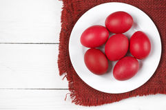 Red Easter eggs in plate Stock Images