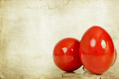 Red Easter eggs on vintage paper Royalty Free Stock Images