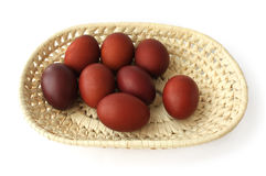 Red Easter eggs in a wicker tray Royalty Free Stock Images