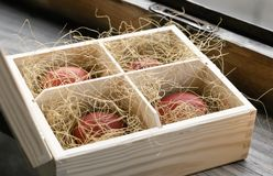Red Easter eggs in a wooden box Royalty Free Stock Photography