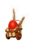 Red egg. Red easter egg in a basket made of wood with some wheat Stock Photo
