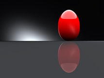 Red egg. Shiny red egg on black background Stock Photography