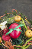 Red egg with green  ribbon with easter decorations Royalty Free Stock Photography