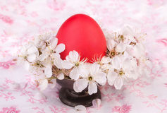 Red egg on metal vintage dish Stock Images