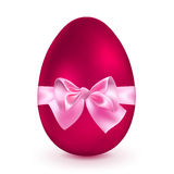 Red egg with pink bow Royalty Free Stock Images