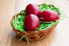 Red eggs in a basket Royalty Free Stock Images