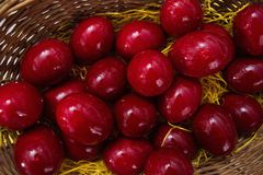 Red eggs on a basket. Easter red eggs in a basket,at the Easter season in a Greek town Stock Image