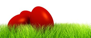 Red eggs in green grass Royalty Free Stock Images