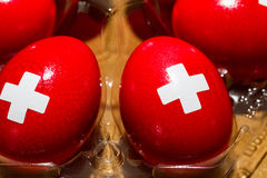 Red Eggs with Swiss Flag Logo Stock Photos