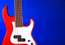 Red Elcetric Guitar Blue Bk. A red electric guitar isolated against a blue background in the horizontal format Stock Photography