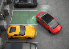 Red electric car driving into parking lot with parking assist system Royalty Free Stock Images