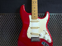 Red electric guitar and amplifier Stock Photos