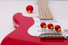 Red electric guitar and Christmas decoration Stock Photo