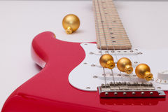 Red electric guitar and Christmas decoration Royalty Free Stock Images
