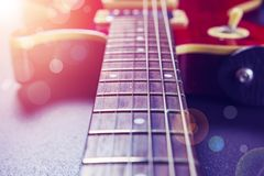 Red electric guitar close-up. Music concept. Vintage guitar on a. Background of sunlight and bokeh royalty free stock photo