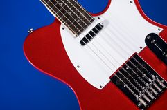 Red Electric Guitar On Green Stock Images