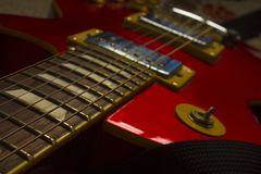 Red electric guitar and strings royalty free stock photos