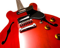 Red electric guitar upright. Wide angle of red electric guitar laying on white background Royalty Free Stock Photos