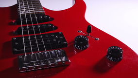 Red electric guitar. volume control. switches animation. rotation
