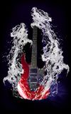Red electric guitar in water Stock Images