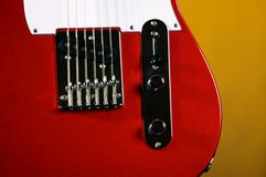 Red Electric Guitar On Yellow Royalty Free Stock Image