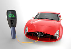 Red electric sports car charging at EV charging station Royalty Free Stock Photo