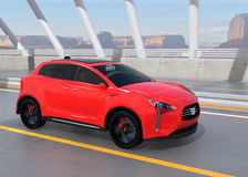Red electric SUV driving on arc bridge Royalty Free Stock Image