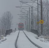 Red electric train in Ceske Budejovice in snow day Royalty Free Stock Photos