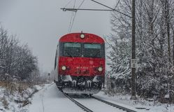 Red electric train in Ceske Budejovice in snow day Royalty Free Stock Photography