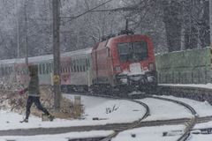 Red electric train in Ceske Budejovice in snow day Royalty Free Stock Photo