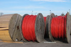 Red electrical cable reels for the transport of electricity high Royalty Free Stock Images