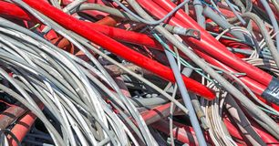 Red  electrical wires in the dump of special material Royalty Free Stock Photos