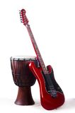 Red electro guitar and japanese drum Stock Photography