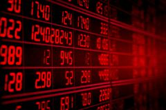 Red electronic board of stock market quotes. Display of red electronic board of stock market quotes. down trend or recession concept royalty free stock image