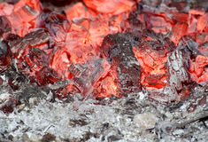 Red embers in stove. Glowing embers and white ashes in stove Royalty Free Stock Photos