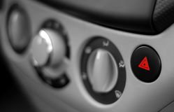 Red Emergency Button on a Dashboard of Car Stock Image