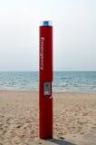 Emergency phone on the beach Royalty Free Stock Photo
