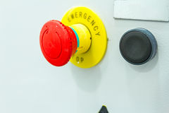 Red emergency stop and black reset button Royalty Free Stock Photos