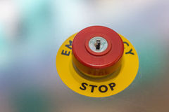 Red emergency stop button on machine for safety Stock Photo