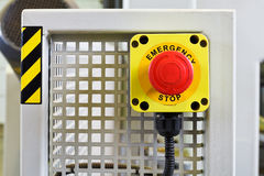 Red emergency stop push button on engine Stock Image
