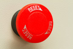 Red emergency stop and reset botton. On gray background Royalty Free Stock Photography