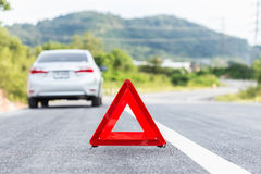 Red emergency stop sign and broken silver car Royalty Free Stock Photos